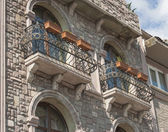 Exterior of a stone building with balcony — Stock Photo