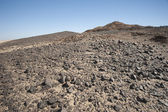 Rocky mountain slope in a desert — Stock Photo