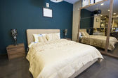 Bed in furniture show room — Stock Photo
