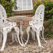 Garden chairs and table on a patio — Stock Photo