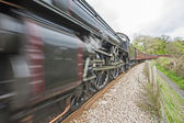 Steam train traveling through countryside — Stock Photo