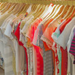 Womens summer clothes hanging on rail — Stock Photo #48734295