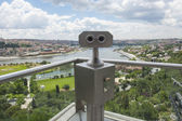 Binoculars on viewing platform overlooking river — Stock Photo