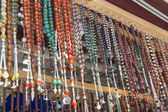 Ornate jewelry hanging at market stall — Stock Photo