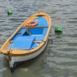Small wooden motor boat moored up — Stock Photo