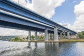 Large bridge over river in city — Stock Photo
