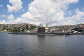 Naval submarine moored in large river — Stock Photo