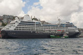 Large cruise ship moored on river — Stock Photo