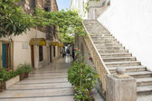 Old passageway in city with steps — Stock Photo