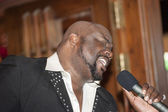 Black african male singing live — Stock Photo