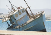 Old abandoned fishing boat wreck — Stock Photo