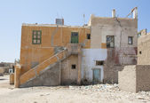 Old abandoned building in egyptian town — Stock Photo