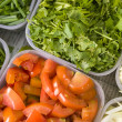 Coriander and tomatoes in a plastic tray - Stockfoto