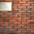 Dirty Sign on Old brick wall — Stockfoto