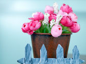 Fake plastic tiny pink and red roses — Stock Photo