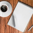Sketch book Silver pen and White cup of hot coffee — Stock Photo
