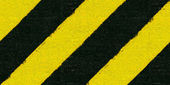 Warning black and yellow hazard stripes texture — Stock Photo