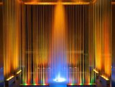 Fountain, multicolored illuminated flowing water by night — Stock Photo