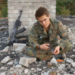 Teenager, boy in battle dress, of knife and rifle, Air Soft Gun — Stock Photo #35834597