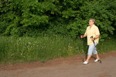 Mature Lady cultivate the Nordic walking — Foto de Stock