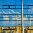 Architecture, abstract, reflection residential blocks in the glass facade, urban scene — Stock Photo