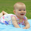 Baby, girl, seven-month-old child lying on blue blanket — Stock Photo #36278701