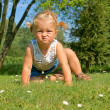 Child, little girl having fun on the meadow, with a grimace on his face — Stock Photo