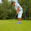 Stock Photo: Golf, Golfer thrusting ball into hole