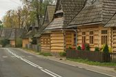 Architecture, wooden highland cottage in Chochołów, covered with shingles, Tatra Mountains, Poland — Stock Photo