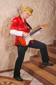 Man playing an electric guitar — Stock Photo