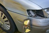 Car crash, the vehicle with a damaged fender, bumper and blinker — Stock Photo