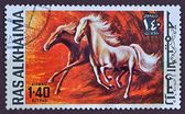 Postage stamp, painted horses — Stockfoto
