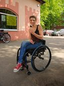 Disabled woman smiling and eaten ice cream, urban scene — Stock Photo