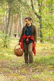 Mushrooming, woman picking mushrooms in the forest — Stock Photo