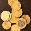Stock Photo: Euro coins on dirty dark background