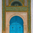 North African architecture - blue doors and ornaments — Stock Photo