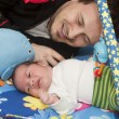 Stock Photo: Newborn baby and father