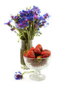 Strawberry in a glass vase — Stock Photo