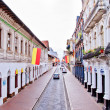 Streets of Cuenca Ecuador during the festivities with city flags - Stock Photo