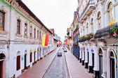 Streets of Cuenca Ecuador during the festivities with city flags — Stock Photo