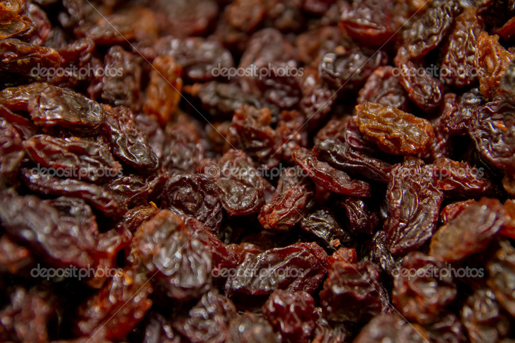 Close up of a group of black raisins  Stock Photo #12498438