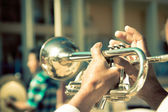 Street band playing, selective focus on the hands with trumpet — Stok fotoğraf