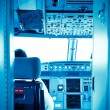 Royalty-Free Stock Photo: Commercial airplane interior cockpit color processed blue