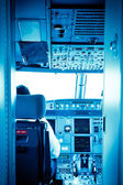 Commercial airplane interior cockpit color processed blue — Stock Photo