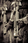 Soldier in formation with armo assault rifle — Stock Photo