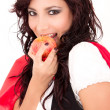 Little Red Riding Hood eating an apple — Stock Photo