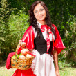 Little Red Riding Hood posing with an apple basket — Stock Photo #13560943