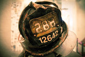 Firefighters memorial helmet NY USA color toned — Stock Photo