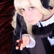 Beautiful cosplay young woman with a pipe — Stock Photo