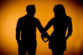 Couple silouette photography holding hands — Stock Photo